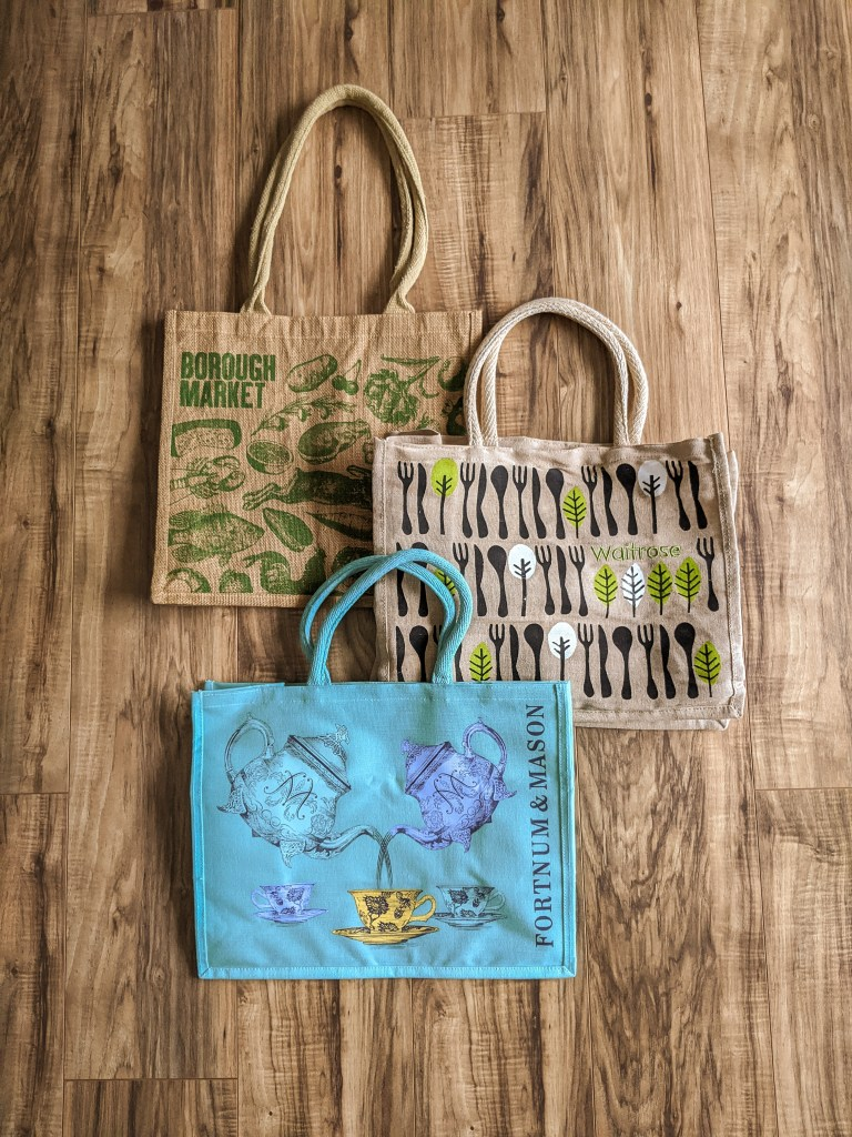 tote bags from borough market, waitrose, and fortnum and mason in London