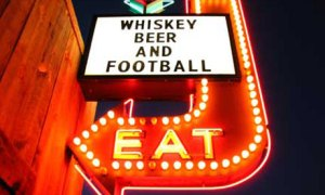 Whiskey, beer and football arrow sign