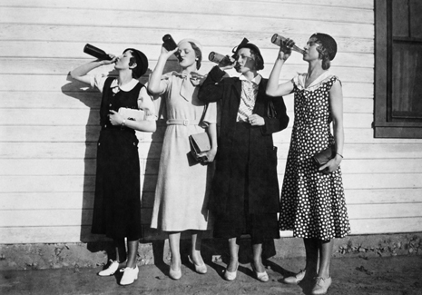 26 Dec 2011 --- Four women line up along a wall and chug bottles of liquor in the 1920s.   --- Image by © Kirn Vintage Stock/Corbis