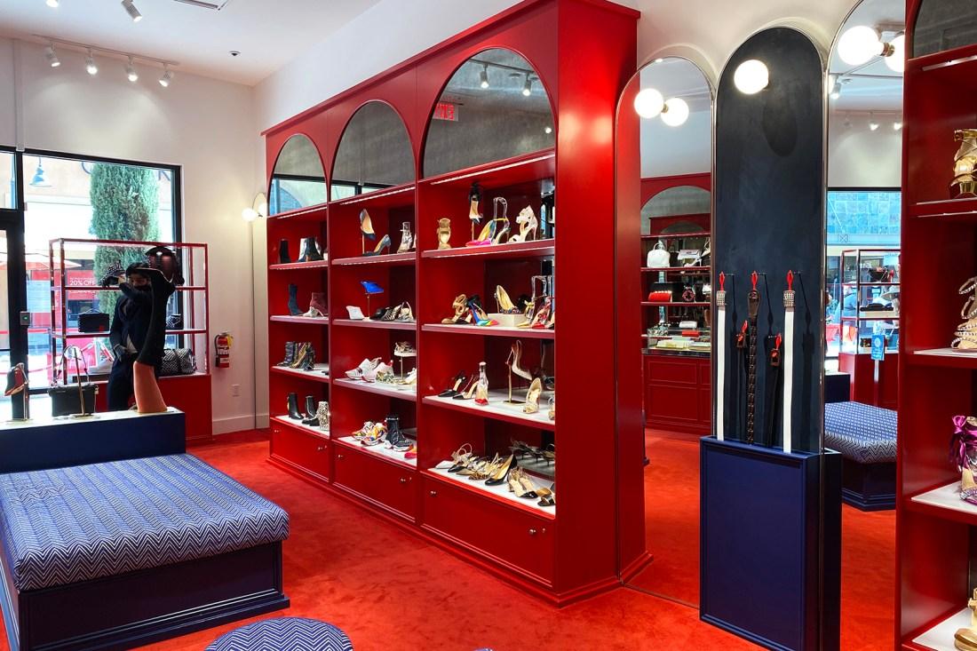 Women's Shoe Wall in the Christian Louboutin Outlet (The Luxury Lowdown Blog)