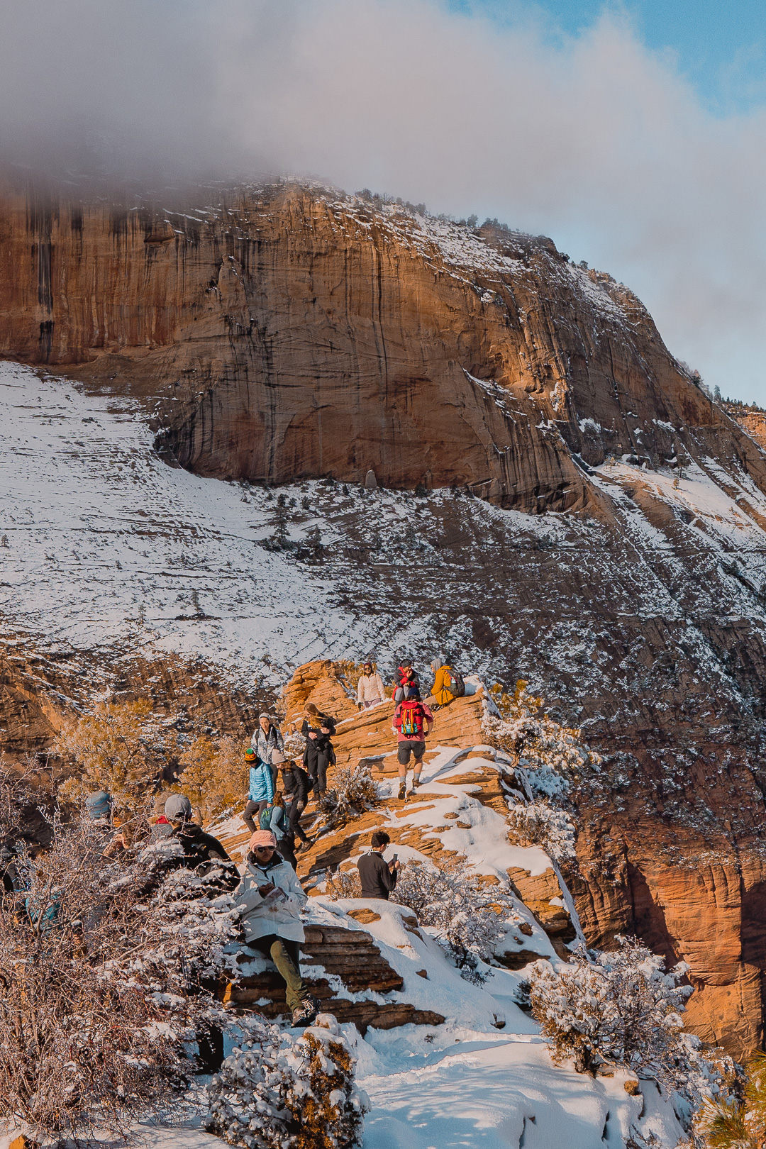 People Hanging at the Top of Angels Landing in Winter