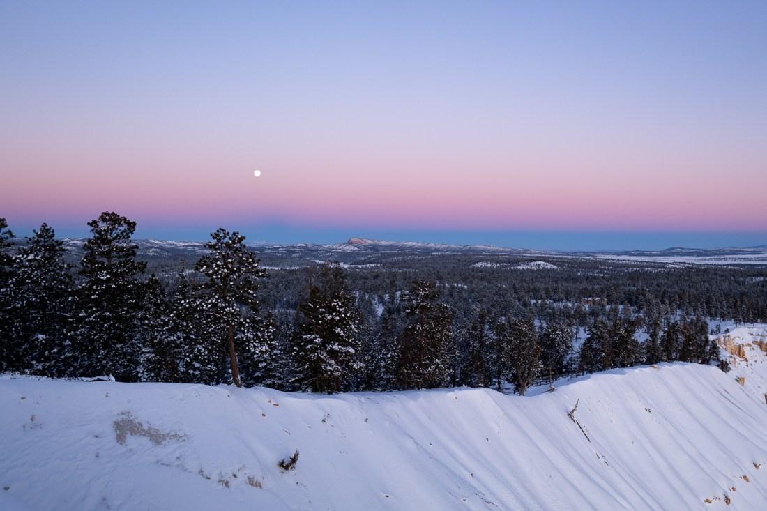 Full moon setting on left side of Upper Inspiration Point