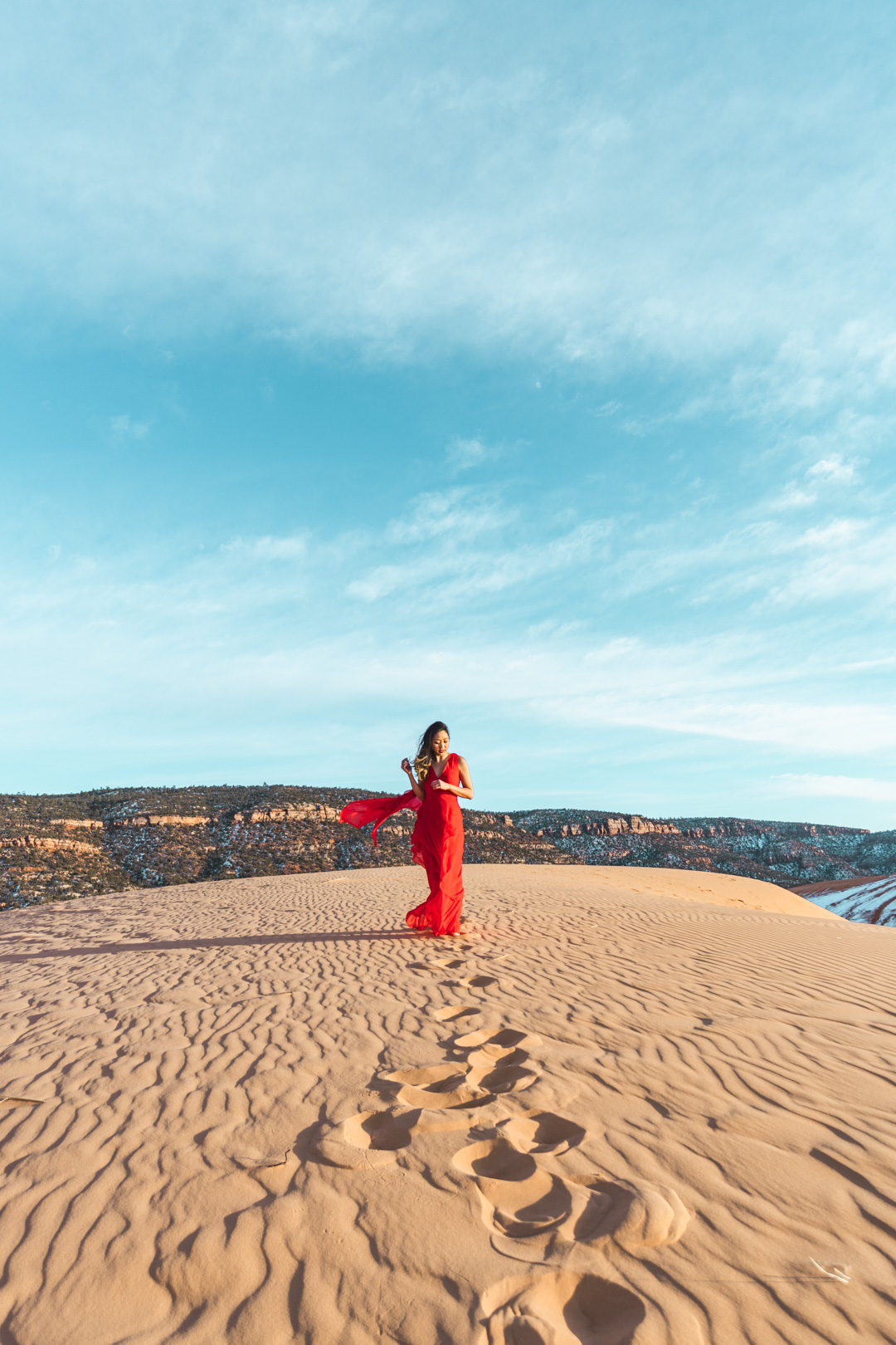 Wearing a red dress at Coral Pink Sand Dunes State Park
