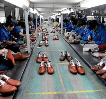 Workers at a shoe factory in Zhejiang Province, China. A new study finds that benefits from trade to the American economy may not always justify its costs in lost jobs. Credit Lang Lang/Reuters