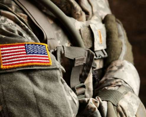 "Why is The U.S. Flag Worn ""Backwards"" on The Uniform? , this is why the flag is backwards on the military uniform,"
