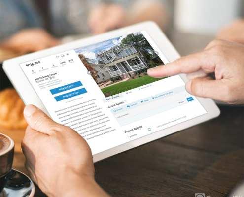 Man doing real estate property search on ipad using Showcase IDX