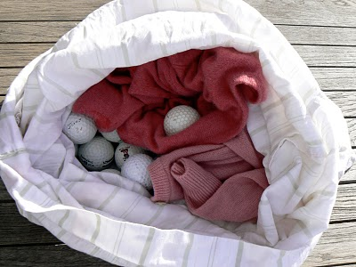 Golf balls in the pillowcase for felting a recycled sweater