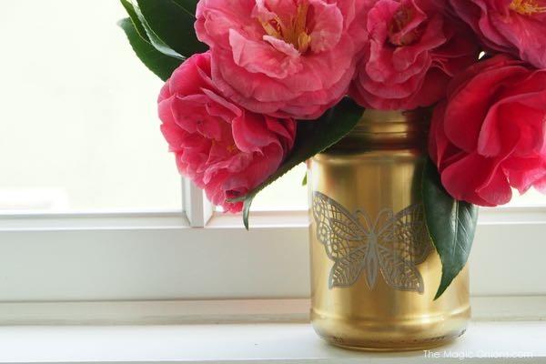 photo of a diy gold spray painted mason jar vase craft