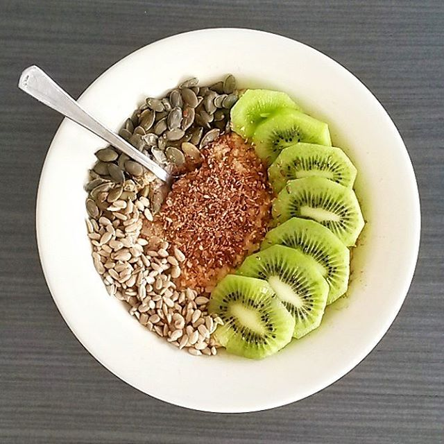 A bowl of oatmeal topped with nuts amp seeds Myhellip