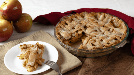 apple pie homemade sliced apples red background lattice