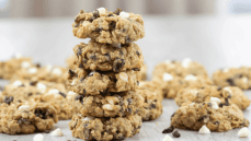 cranberry white chocolate chip oatmeal cookies stacked gray background