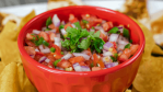 pico de gallo in red bowl and tortilla chips