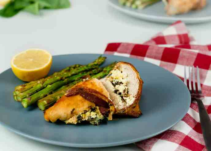 Instant Pot Stuffed Chicken Breasts on gray plate and served with asparagus