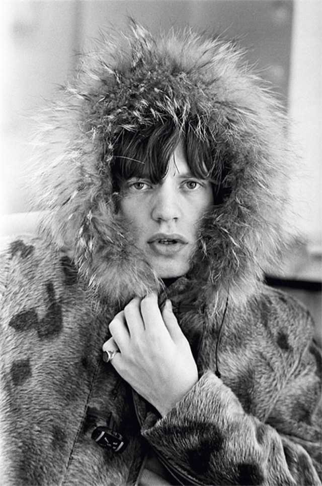 Mick Jagger posing in a fur parka, with a fur trimmed hood, 1964 ©Iconic Images/Terry O'Neill