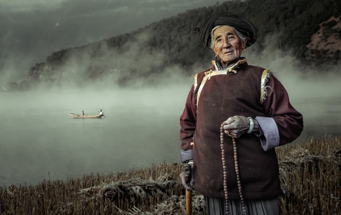 Photographed at Lugu Lake in Liangshan,China on December 11th ,2016, Mosuo People still remain the matrilineal great family and mysterious Walking marriage