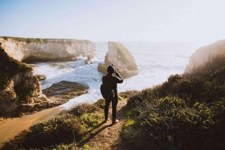 Berty standing above Shark Fin Cove California