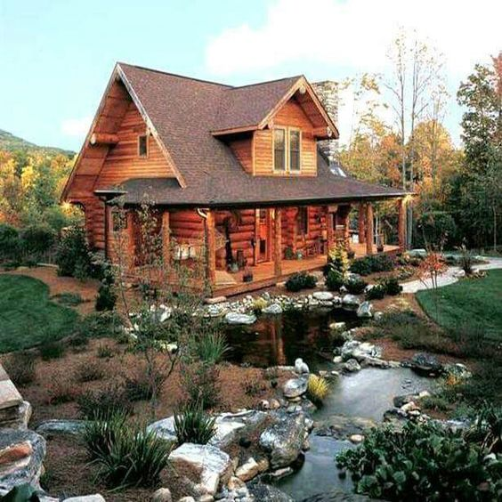 log cabin near creek