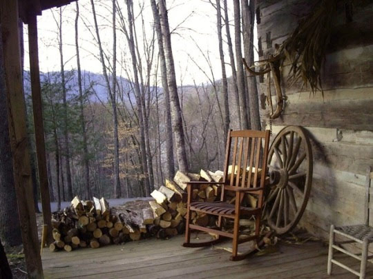rocking chair on porch with firewood