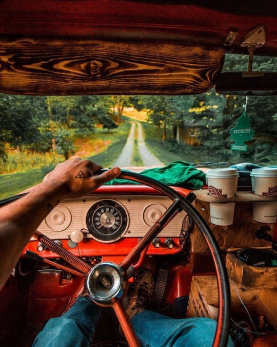 man driving old truck down country road