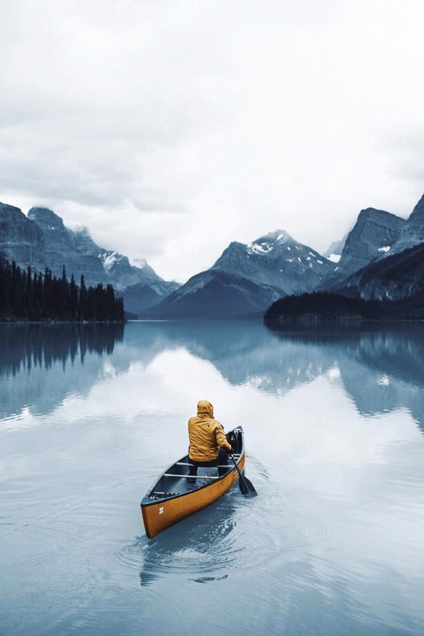 man paddling alone