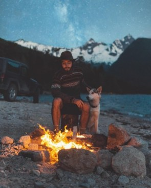 a man a dog and a campfire