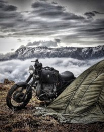bmw motorcycle with tent and mountains