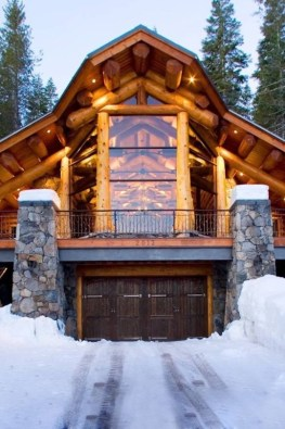 driveway of winter cabin covered in snow