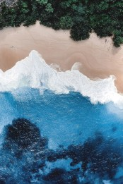 overhead shot of blue water and beach