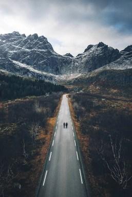people walking on long mountain road