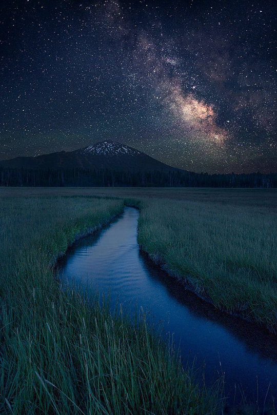 quiet stream with mountain and start at night