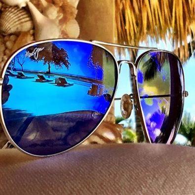 sunglasses reflecting beach scene
