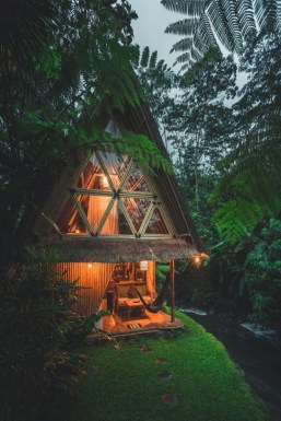 tiki hut style cabin by a river