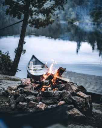 campfire and boat by a dock