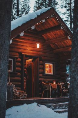 dark wood cabin in snow