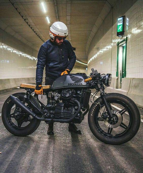 man next to a honda mototcycle