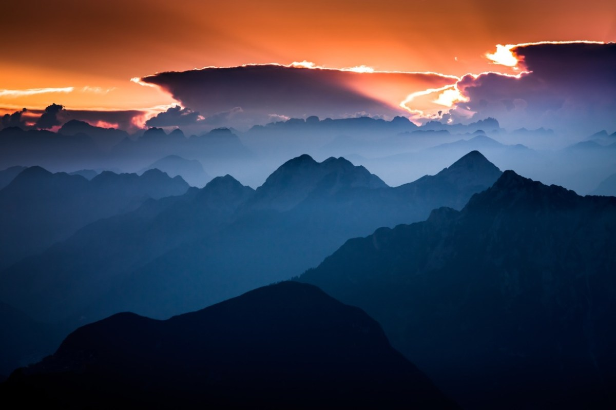 dramatic clouds over mountains