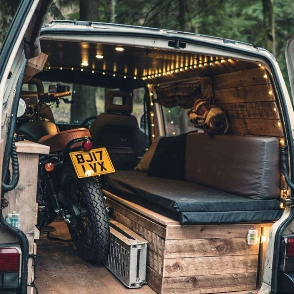 camper van with motorcycle in back