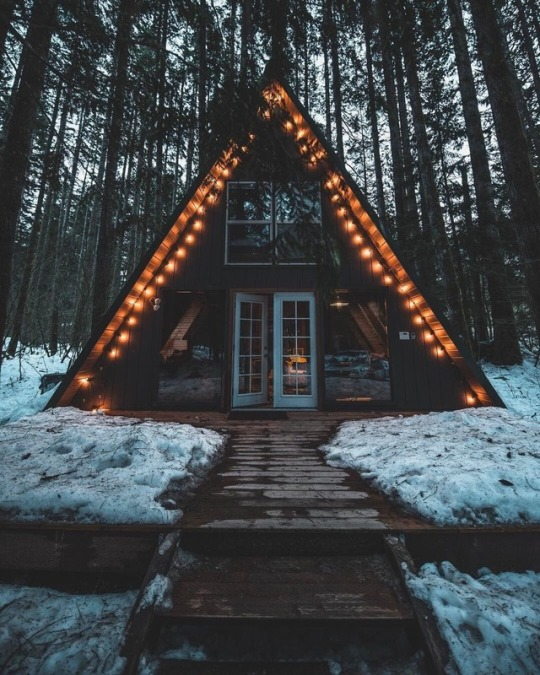 a frame cabin with lights