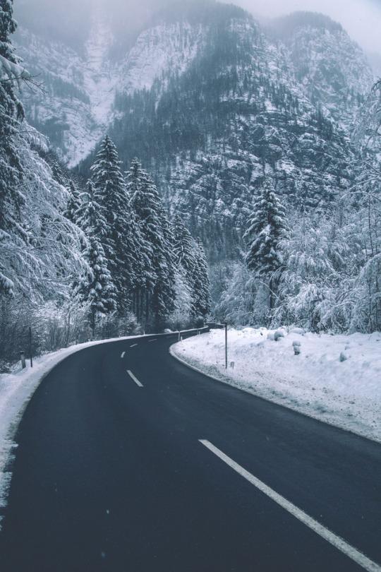 snowy road through mountains