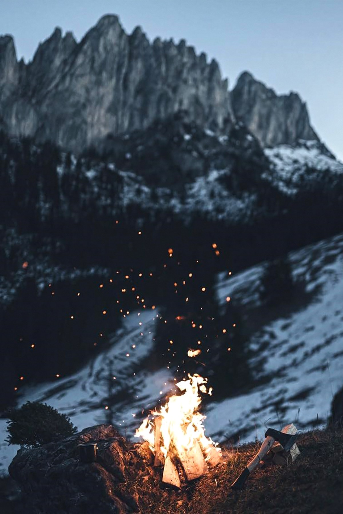 mountain snow scene with campfire