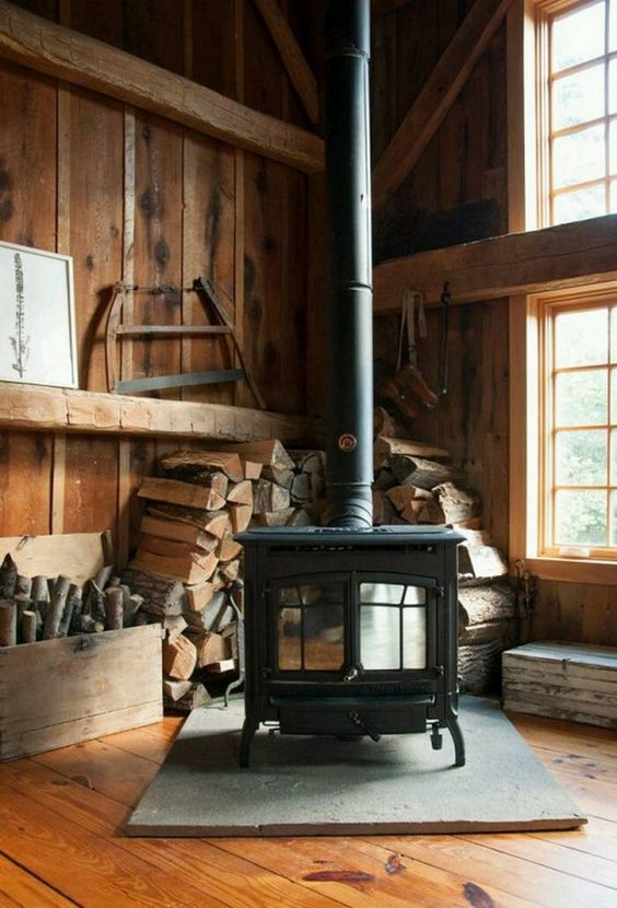 wood burning stove inside cozy cabin