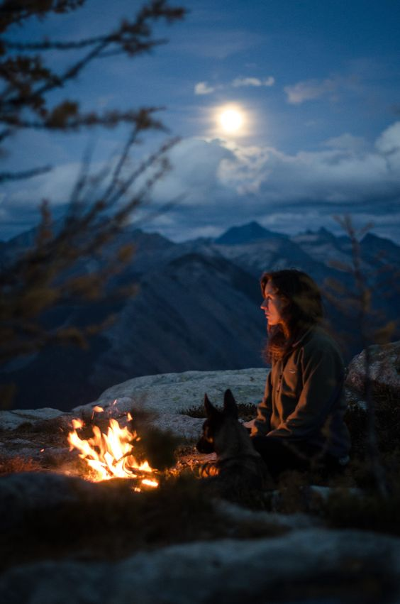 camp night with woman and dog