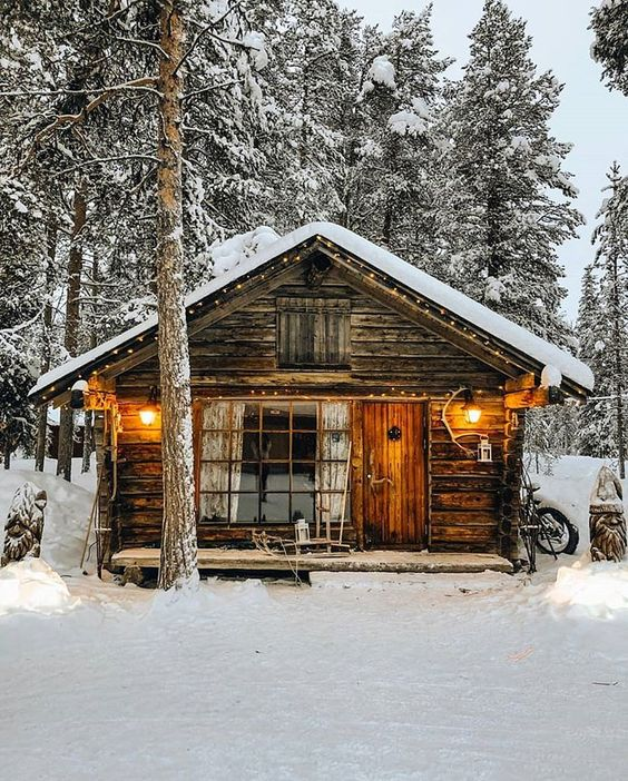rustic cabin in the woods with snow