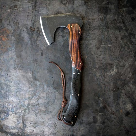 sturdy ax with nice wood grain handle