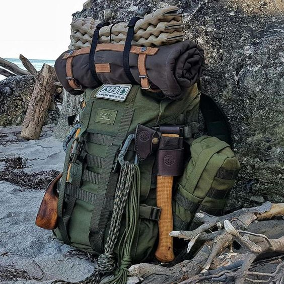 backpack with axe and camping gear