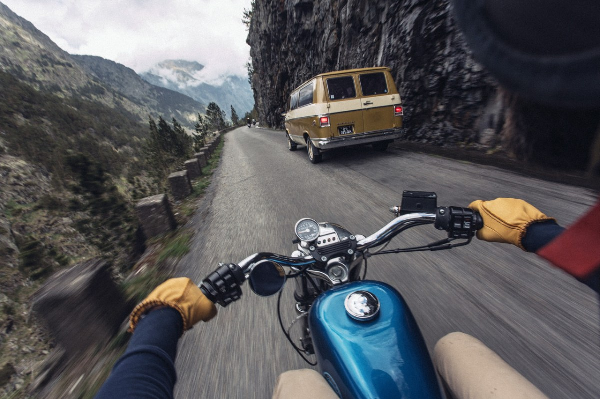 navigating a mountain road on a motorcycle