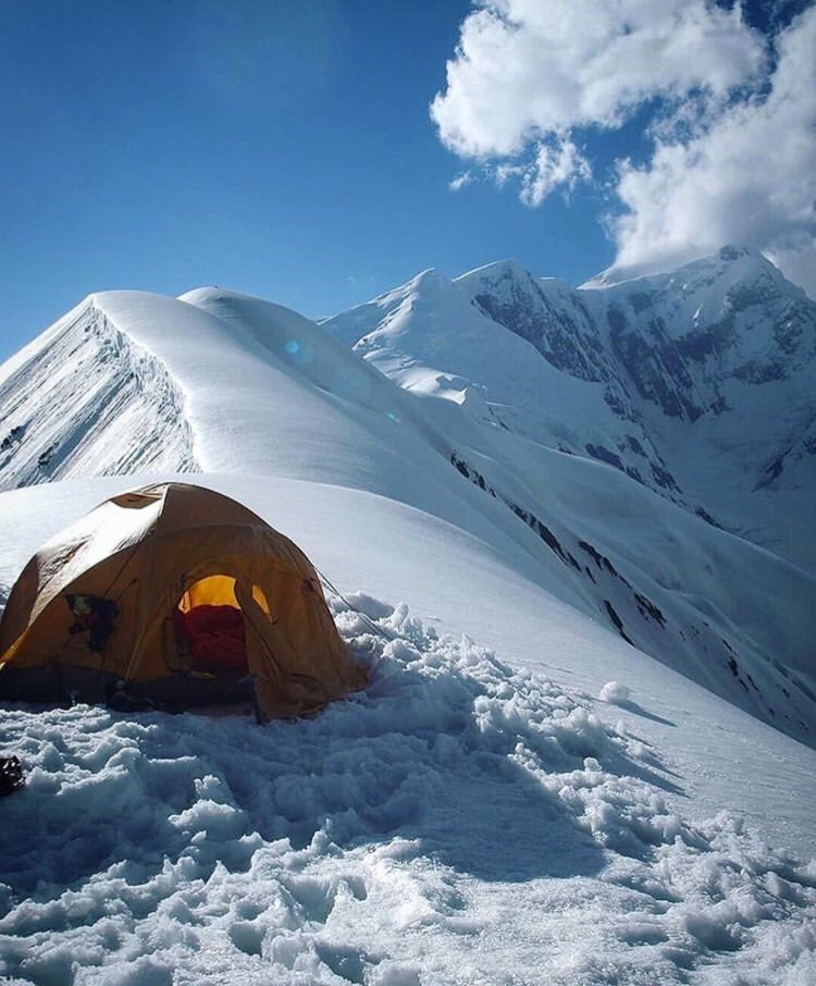 tent on snow-covered mountain top