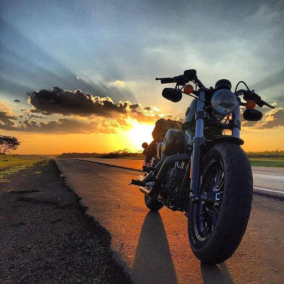 a motorcycle and a sunset
