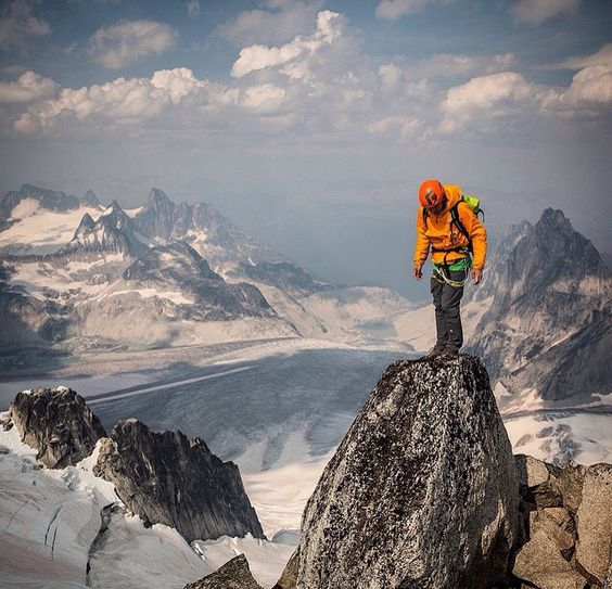 climber standing on mountain top