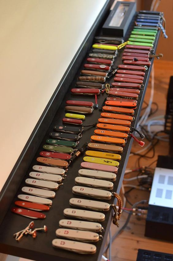 colorful collection of pocket knives